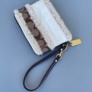 Coach - small wristlet - about 6 x 4 inches